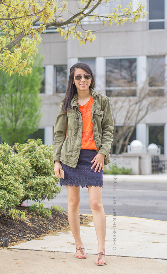 green military jacket, orange lace tank top, lace navy mini skirt, brown sandals, cognac brown tote