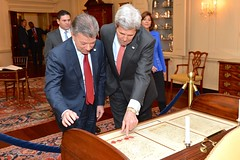 U.S. Secretary of State John Kerry shows Colombian President Juan Manuel Santos the desk on which Thomas Jefferson wrote the Declaration of Independence in the John Quincy Adams State Drawing Room at the U.S. Department of State in Washington, D.C., on February 5, 2016. [State Department photo/ Public Domain]