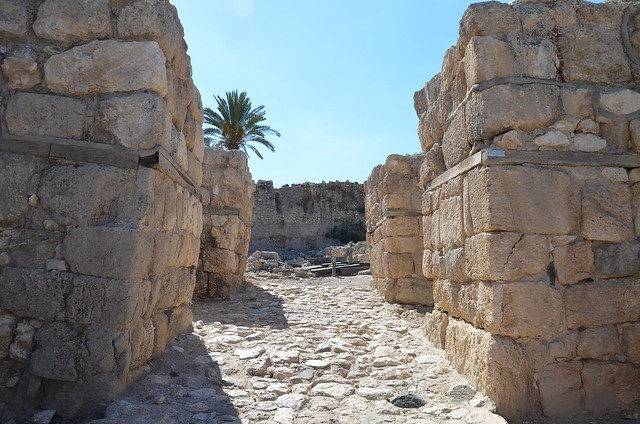 The Canaanite city gate dating to the Late Bronze Age period (1150-1150 BC), the gates were faced with ashlar block, some made of basalt, Tel Meggido, Israel