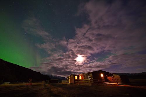 hut, clouds and auroras