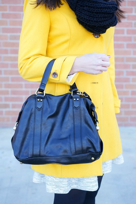 yellow winter coat + gray flare skirt + black sweater + black knit scarf; winter outfit for work
