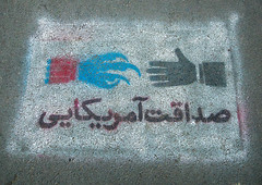 anti-american propoganda painting saying honesty and friendship of  america, on the pavement of of the former united states embassy, Central district, Tehran, Iran