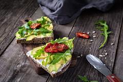 Avocado, goats cheese and arugula toast