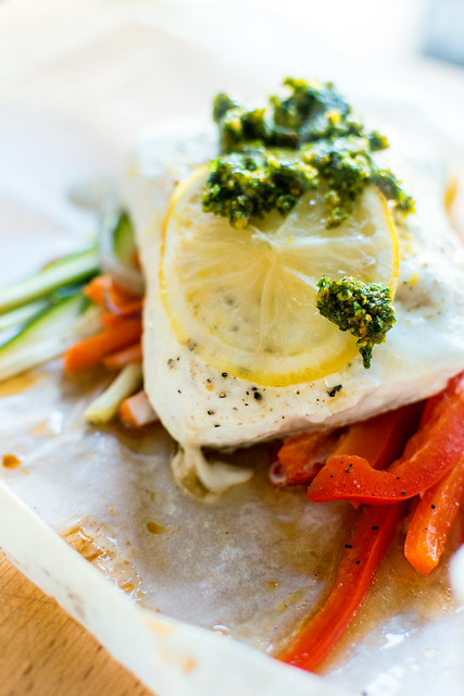 Halibut Baked in Parchment with Pistachio Mint Pesto | New recipe from Eating in the Middle by Andie Mitchell highlited on GirlCarnivore.com #whole30approved easy weeknight dinner!