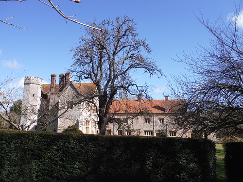 Notley Abbey across garden hedge, from footpath to the SW
