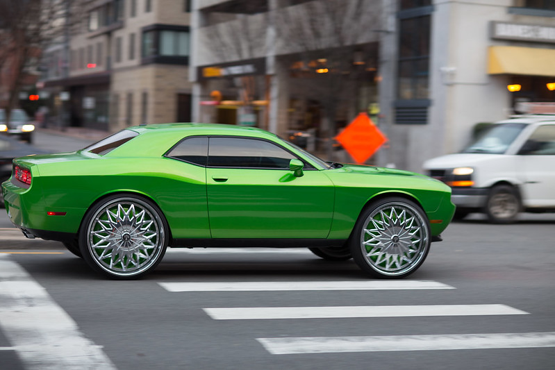 green car on dubs