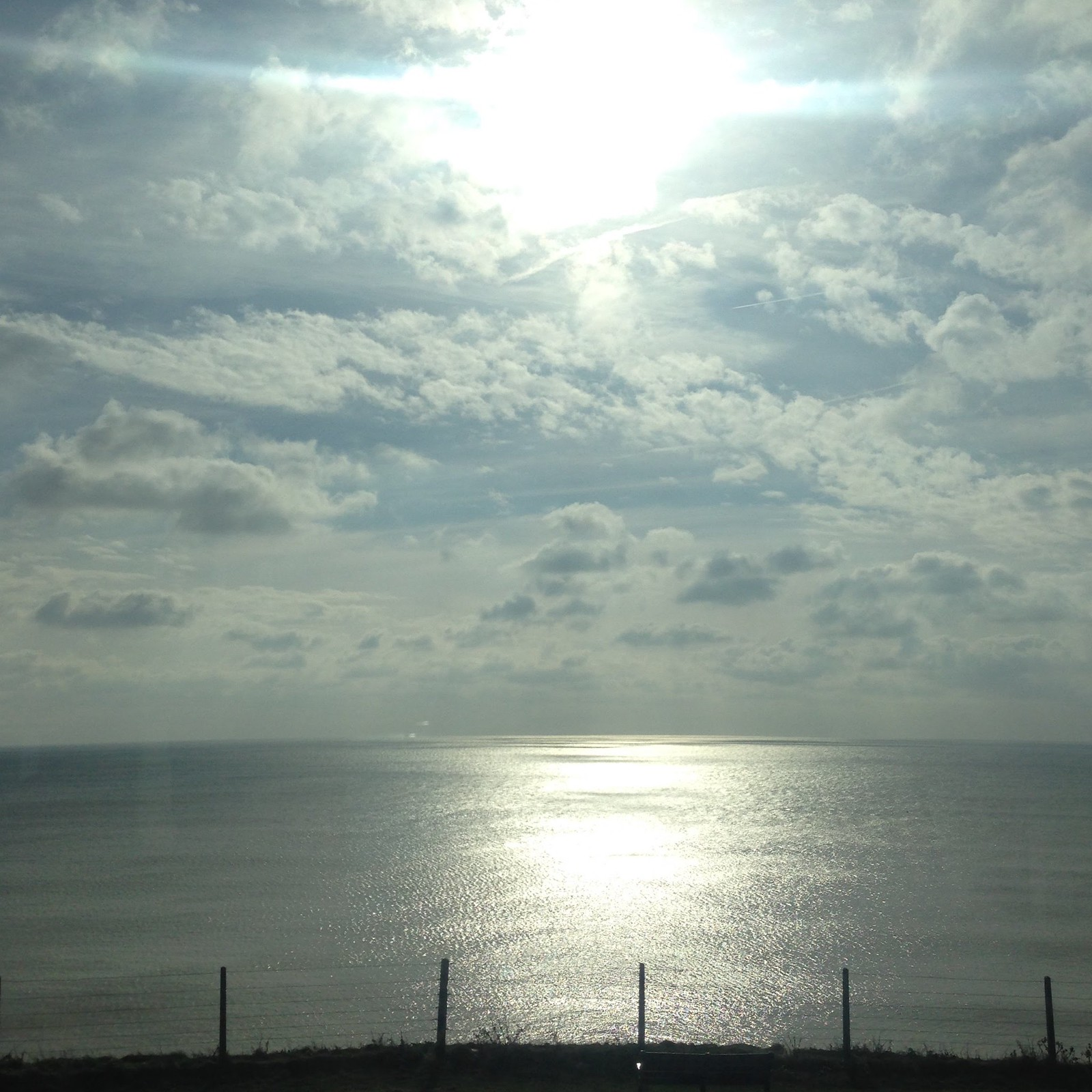 the sea from the bus on a sunny day
