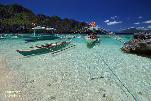 boats and passengers on beach, Shimizu Island