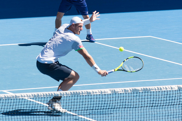 Lleyton Hewitt plays doubles with Sam Groth  at the Australian Open 2016