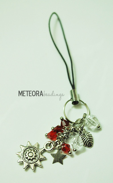 Phone chain - red and clear beads, with silver star, leaf and sun charms