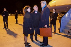 U.S. Secretary of State John Kerry speaks with U.S. Embassy Berlin Deputy Chief of Mission Kent Logsdon and U.S. Consulate General Munich Consul General Jennifer Gavito after disembarking from his airplane on February 10, 2016, following a flight from Andrews Air Force Base in Camp Springs, Maryland, to Munich International Airport in Munich, Germany, so he can attend meetings focused on Syria and also address the Munich Security Conference. [State Department photo/ Public Domain]