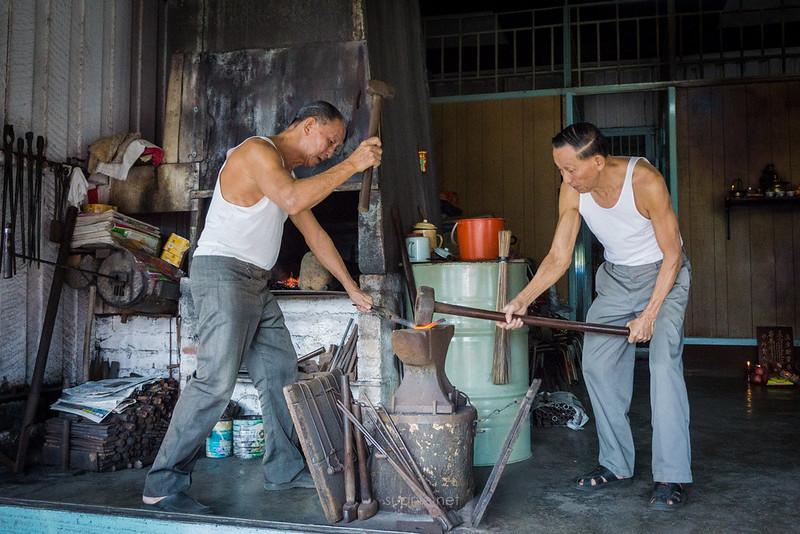 Blacksmith Sri Gading - pounding iron on anvil