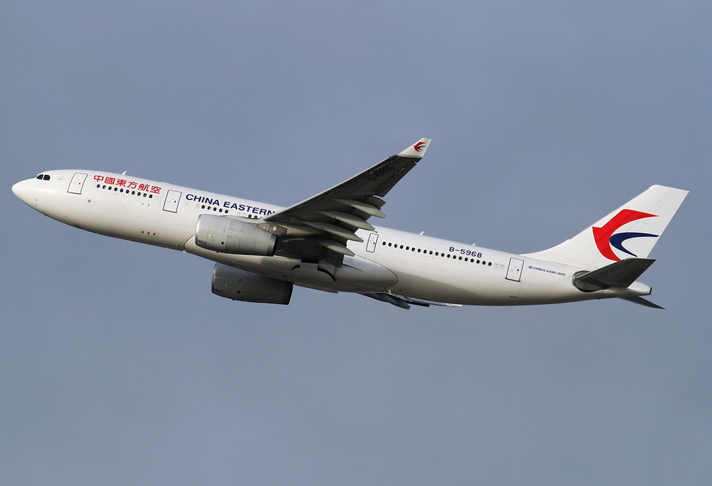 MU220 to Shanghai PVG climbing out of RWY25C. What a boring livery this is... Delivered 02/2015.