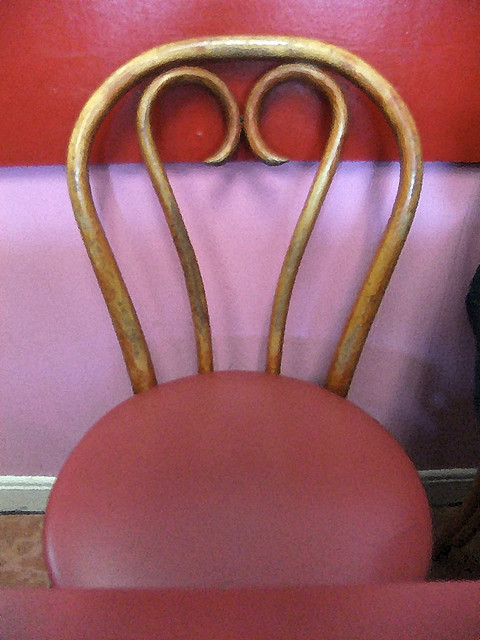 Chair at the pink Au Petite Café in Vancouver, BC