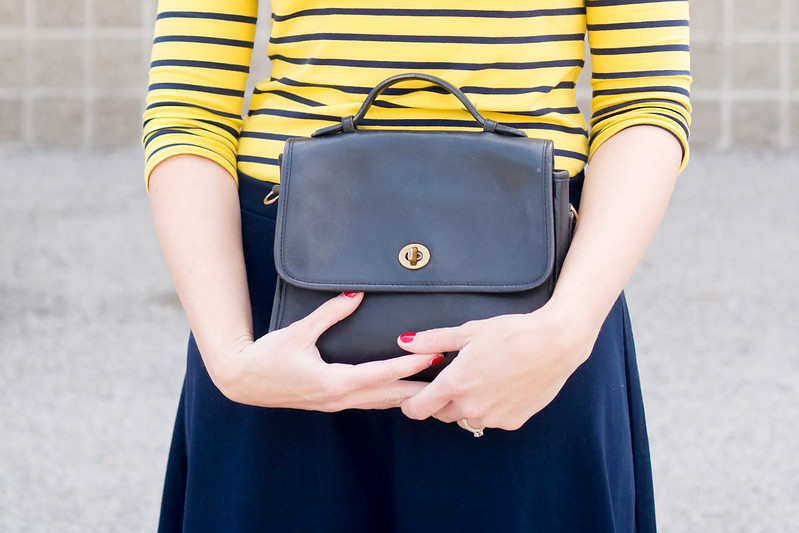 yellow and navy stripe tee, navy Loft sunglasses, trench coat, navy Old Navy flare skirt | Style On Target