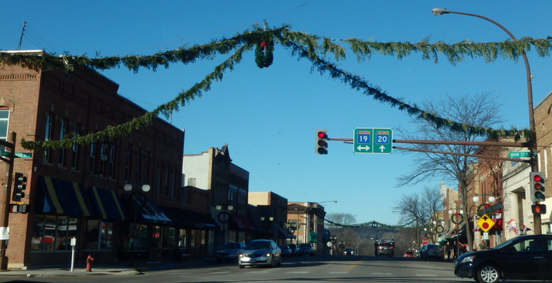 four garland strands at the street corners, meeting at a wreath in the middle