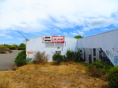 Abandoned former Sprint Auto Parts building - Cnr The Grove Way/The Golden Way