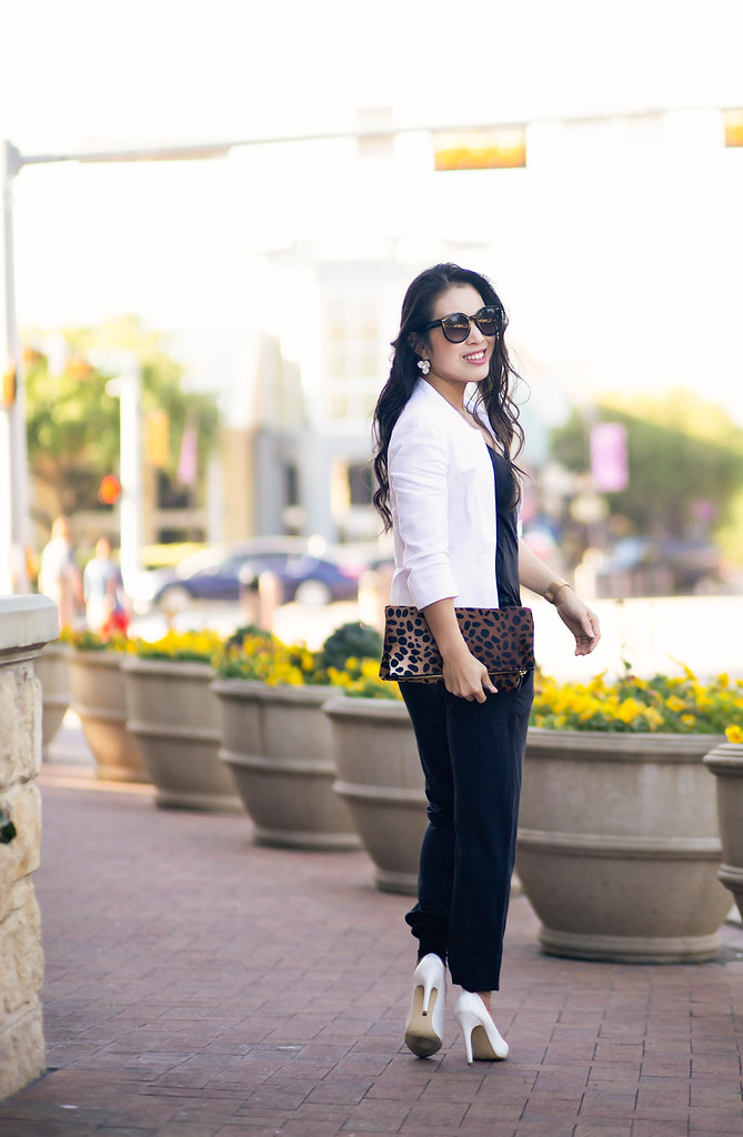 cute & little blog | petite fashion | white cropped blazer, black alala jumpsuit, white pumps, leopard clutch, layered pendant necklace, kate spade pansy earrings | spring outfit
