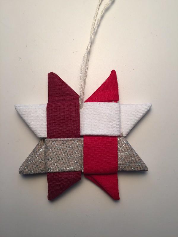 Folded fabric star ornament