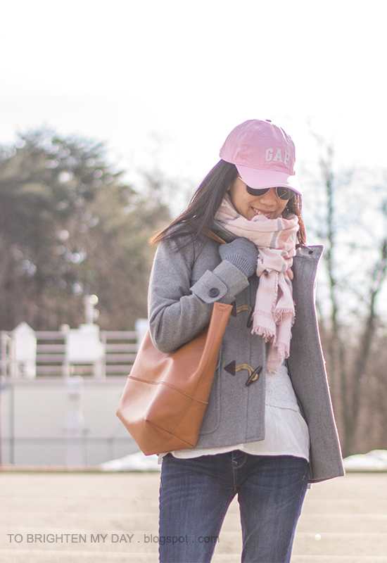 pink cap, pink striped blanket scarf, gray toggle coat, ruffled sweater
