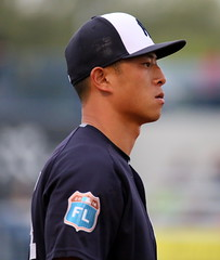 Rob Refsnyder looks on from third