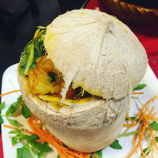 Wish I was eating this for lunch today. Vietnamese shrimp curry served in a coconut. My spinach & broccoli peanut noodles with poached eggs is nowhere near as photogenic.