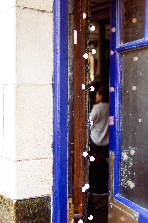 columbia road pub door with fairy lights