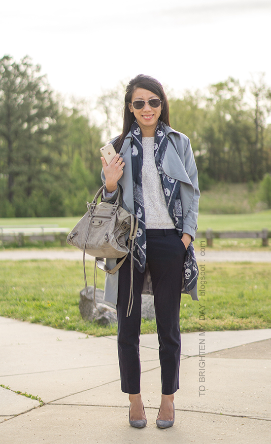 gray blue drape trench coat, short sleeve marled sweater, navy skull printed scarf, navy pants, gray suede pumps