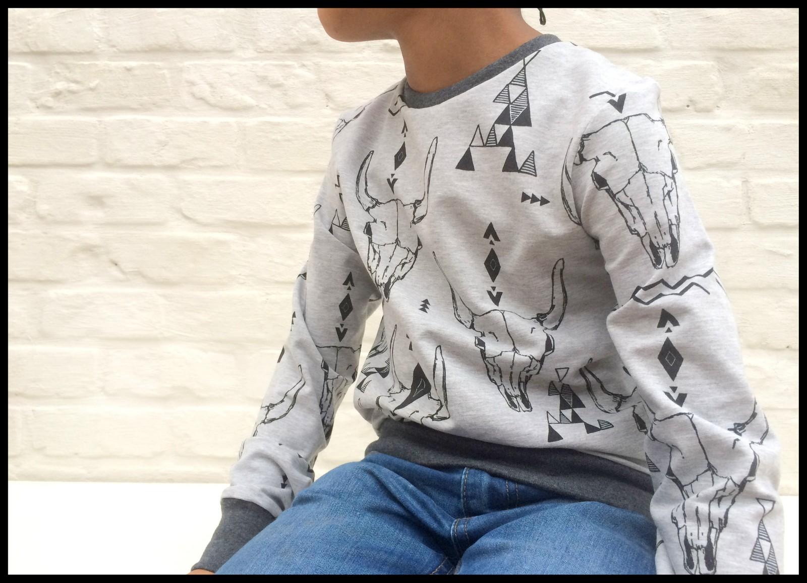 skulls sweater (sitting)