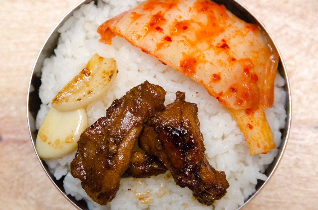 Sae Ma Eul BBQ chicken on a bowl of rice