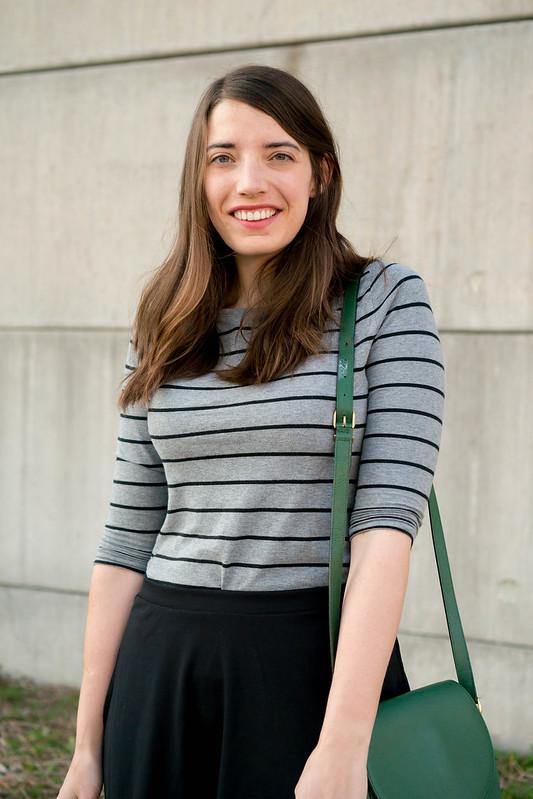 gray striped tee + black flare skirt + green purse + Old Navy black slide sandals | Style On Target