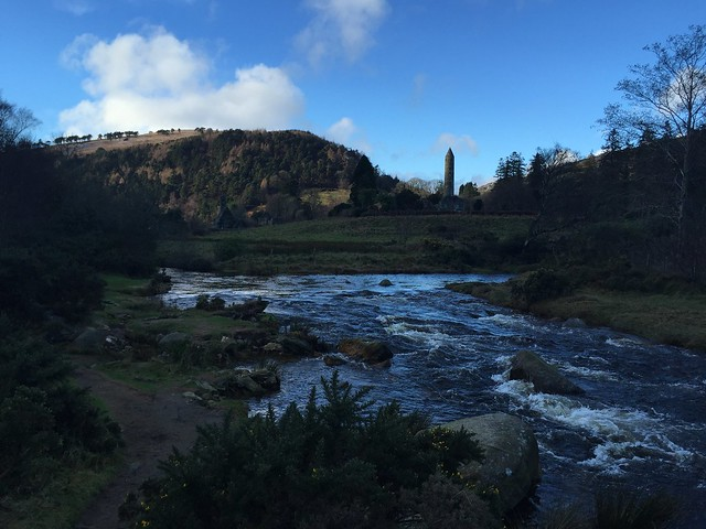 Glandalough Ireland, river with round tower in the background