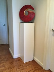 White Laminate Pedestal With Red Sculpture