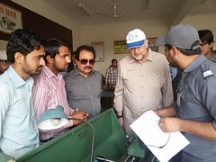 Mr. Carsten Mueller and Wajid Junejo intercating with student at technical training center