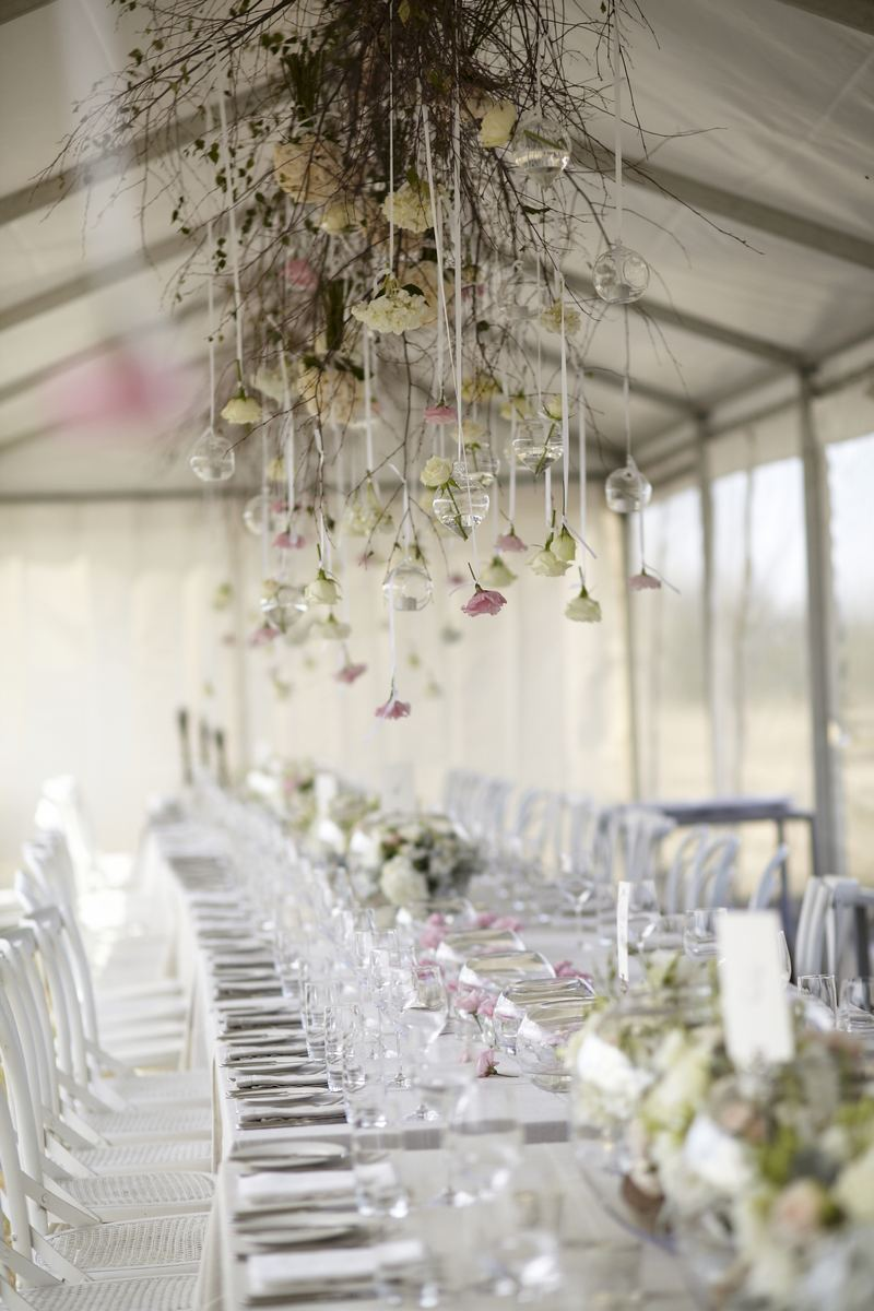 Gorgeous wedding decoration with flowers hung from ceiling - Wedding reception for an outdoor rustic wedding | Photo by Blumenthal Photography | Read this real wedding on I take you - UK wedding blog