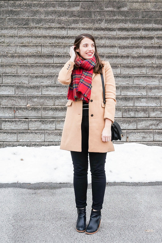 camel winter coat + black quilted purse + red plaid scarf + black white stripe sweater; casual winter outfit