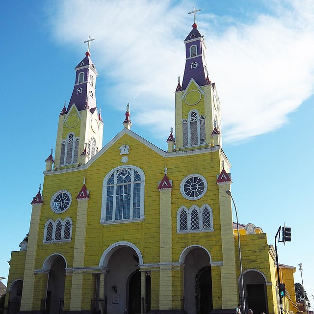 • C a s t r o • I don't know about you, but when I think of churches I automatically think of the colour white. Unless I'm in Chiloe, and specifically in Castro. Today the church is yellow and purple, when I lived here it was orange. I can't think of anyw