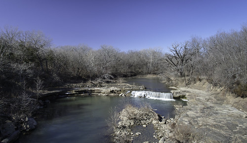 winter water waterfall rocks stream shadows baretrees