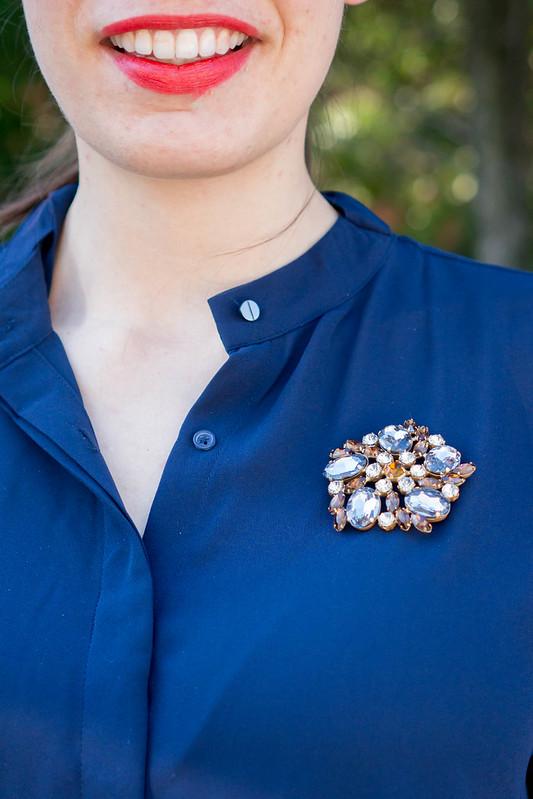 navy work blouse + blue gingham skirt + vintage brooch + loft sunglasses + spring summer work outfit