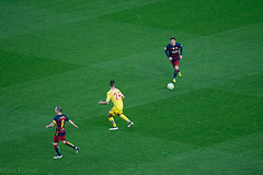 Messi, Iniesta and some chap from Sporting Gijon.