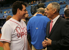MLB Commissioner Rob Manfred and John H. Schnatter, the CEO of Papa John's