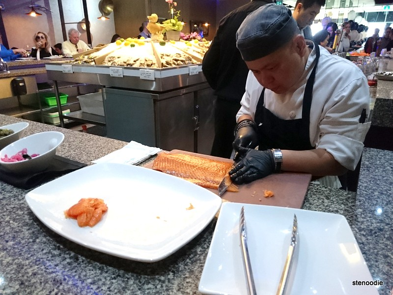 chef slicing smoked salmon