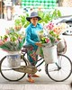 Vietnames flower vendor on bike at Ho Chi Minh. #meetthelocals #thecamhipster #vietnam