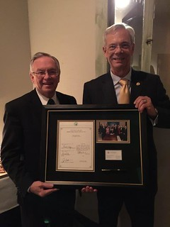 Rep. Larry Haler receives an award from Dr. Keith Watson, President of the Pacific Northwest University of Health Sciences