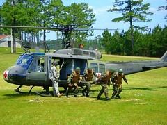 SeaBees form NMCB-21 conduct medevac drills at Camp Shelby Mississippi prior to their deployment of Afghanistan.