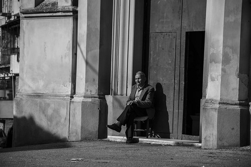 Old man sitting on the door of St. Rocco