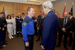 U.S. Secretary of State John Kerry thanks a French police officer who was supposed to ride with him on May 31, 2015 - when he fell on his bike and broke his leg - as he visited the U.S. Mission in Geneva, Switzerland, and thanked the first responders who treated him after his accident in nearby France. [State Department photo/ Public Domain]