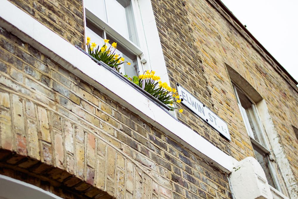 Elwin Street sign brick houses london