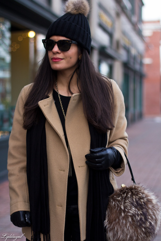 black jeans, black sweater, camel coat, fur pom hat.jpg