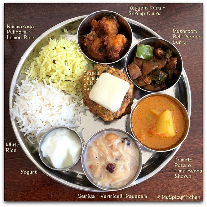 A platter of Telangana food - white rice, lemon Rice, shrimp curry, mushroom bell pepper curry, tomato potato shorva, vermicelli payasam and yogurt